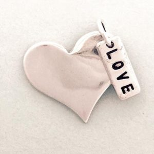 Heart charm with love label on the magick minx website