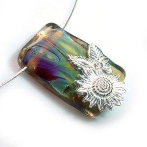 Glass pendant bee and sunflower on the magick minx website