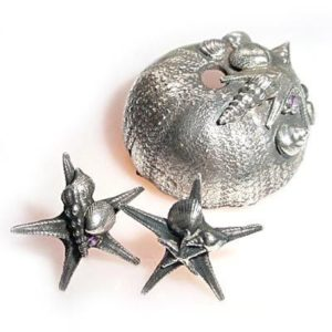 Starfish earrings and urchin piece on the magick minx website